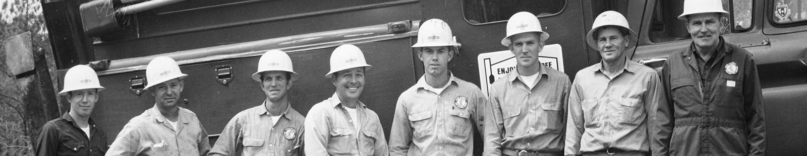 Black and white picture of men in hard hats